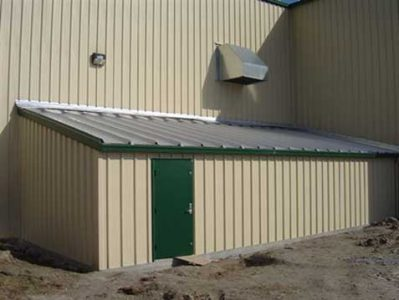 A connecting tornado safe room for protection of plant personnel. Access to the safe room is through an interior FEMA-compliant tornado door; occupants may exit through an exterior tornado door.