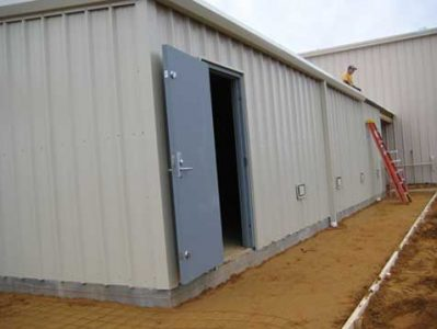 The exterior of a connected tornado safe room is finished to match the décor of the existing building exterior.