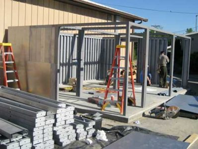 The safe room components are assembled on a concrete foundation.